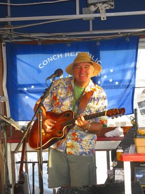 island bill performing at billy's stonecrab bar