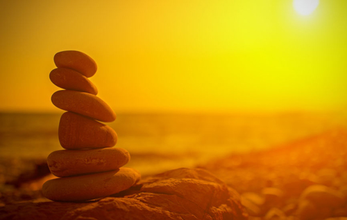 Stacking rocks at sunset honors the day and extends a blessing for a more peaceful tomorrow.