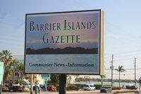 barrier island news sign