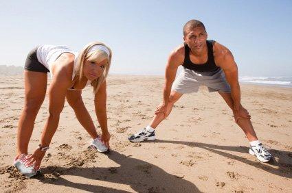 beach workout couple warming up