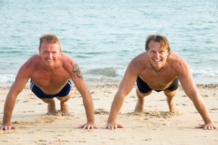 a beach workout with a buddy can be real competitive