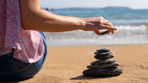 Stacking rocks on the Florida beach is a timeless tradition of peace and connection.