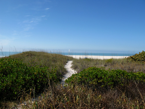 sunset beach boardwalk path to blind pass jetty