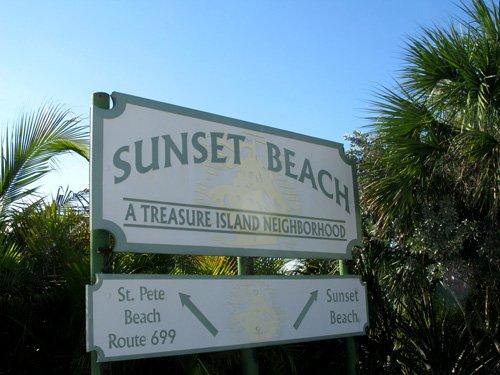 sunset beach direction sign on gulf blvd